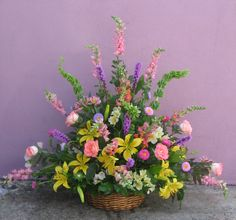 Funeral basket #8   Typically sells for 175.00      This lush garden flower basket is brimming with snapdragons, lilies and fragrant pink roses. Ask us for our daily listing of dutch and garden type flowers to include in your tribute.