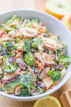 The ORIGINAL Broccoli Salad Recipe - loaded with broccoli, apples, craisins and pecans, and tossed in a creamy lemon dressing. A must-try broccoli salad!   natashaskitchen.com