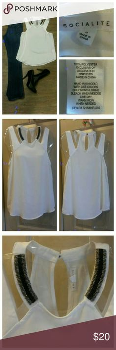 White sleeveless top Sexy sleeveless top with bead work in the front at neck line. Chiffon like fabric.  Flowy and looks great with jeans.  Washed to get make up off it after I purchased and haven't worn since so like brand new   No defects. Socialite Tops