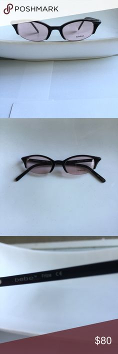 BeBe tinted eyewear Elegant sophistication for your face!  BeBe tinted eyewear is the perfect finishing touch for any effortless chic outfit.  Rose tint with dark brown frame.  Worn only a few times.  In excellent condition.  Buy today...enjoy for years! bebe Accessories Sunglasses