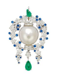 A Cultured Pearl, Emerald, Sapphire and Diamond Pendant/Brooch/Clasp.  Centering a cultured pearl of 19.5 mm, surrounded by a diamond-set vine of floral motifs accented by small sapphire cabochons, topped by a carved emerald leaf, and suspending an emerald cabochon drop, mounted in platinum