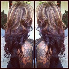 Blonde highlights on top of layered chocolate brown hair