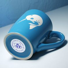 Check out this sky blue narwhal coffee mug from Bread and Badger!