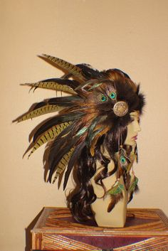 Custom order bronze, gold, copper, brown, green and cream feather headdress with art nouveau medallions. sold