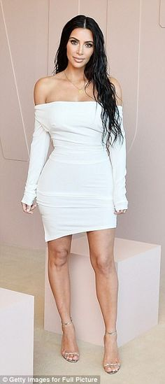 Back to her old self! Kim Kardashian wears shoulderless white dress similar to her MET Gala peasant gown, both by Vivienne Westwood, as she joins Kanye West at KKW makeup launch