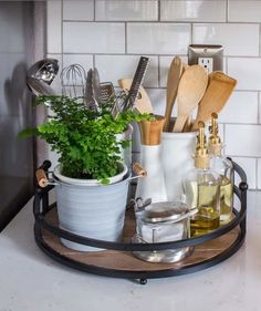 Corral the Counter Clutter | Turn your head for one second, and chances are your kitchen counter will collect some new clutter. The best way to contain the assortment of utensils, spices, canisters, and oils is to find a tray that can hold it all. Start by choosing a tray that's pretty enough to leave on display. Laura from Inspiration for Moms used a rustic wood and metal one, but we also love this chic gold and marble option ($35).