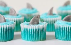 Making shark fin cupcakes is easy and fun! I made these this morning because this week is a special week. SHARK WEEK! I can't help myself during Shark Week. Admittedly Sharks terrify me and the ocean scares me and the idea of being in open water is clearly a nightmare. But I am fascinated with Shark