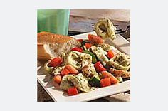 Garden veggies of your choice and prepared pesto sauce make this chicken salad a quick and tasty summertime dish.