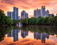 The Midtown skyline from Piedmont Park reflecting in the water of Clara Meer Lake at sunset ~ 10 Best Free Things to Do in Atlanta with Kids