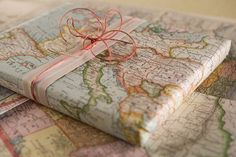Old maps as wrapping paper. Ribbon and twine.