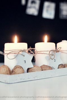 white candles, some plain string and walnuts.