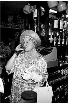 "1987- The 86-year old Queen Mother enjoys a pint of bitter, during a visit to The Queens Head pub in Stepney in London' s East End. She was offered champagne, but turned barmaid and chose instead to pull herself a pint, her verdict ""It's very nice"""