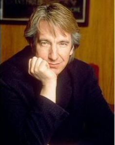 Alan Rickman. This iconic image is from a photoshoot by Didier Olivre in Paris, in 1992