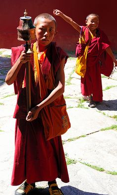 Travel Asian Serious child monk, Tibet, via Flickr.