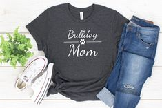 This bulldog mom shirt is so you can proudly show off your title as the coolest dog mom ever! The shirts are super soft and comfortable with a relaxed fit, making it easily your new favorite t-shirt. 10% of your purchase is donated to help dogs in need at local animal shelters. #bulldog #bulldogmom #dogmom Dog Mom Gifts, Gifts For Dog Owners, Gifts For Mom, Pride Shirts, Mom Shirts, Funny Shirts, Equality Shirt, Feminist Shirt, Hoodie Sweatshirts