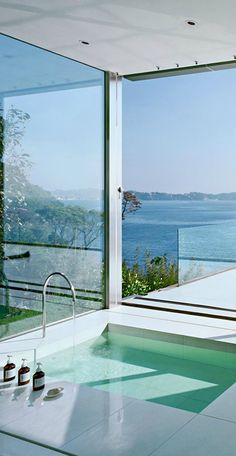 Designing your dream bathroom with a view is all about location, whether perched on the ocean, surrounded by mountains or in a dense forested landscape.