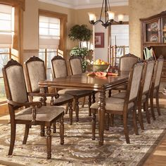 San Martin 9 Piece Dining Table And Chairs Set By Signature Design Ashley