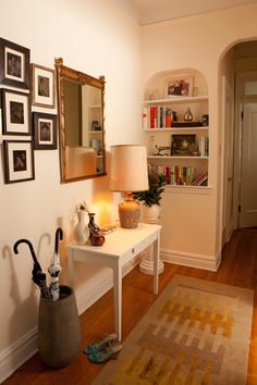mirror, console table, umbrella storage / home of photographer Karen Wise and her husband, Chandler Kauffman, in Park Slope, Brooklyn