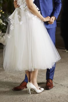 PUT A TWINKLE in your step with a pair of ivory wedding shoes embellished with sparkly encrusted jewels.