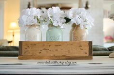 Add a gorgeous rustic planter box with 3 painted mason jars to your home or office décor. This beautiful set is the perfect addition to your rustic or country décor, and can be customized with any color jar combination you would like. The planter box is made of hand-picked, high quality white pine. Its natural knots add individual character and rustic appeal. Each jar is hand painted, distressed, sealed and twine applied to give them lasting beauty. These are great for gifts, as centerpieces…