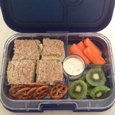 Turkey, cheese, and avocado sandwich squares; carrots with ranch dressing; kiwi slices; and pretzels. All ingredients are Stage One approved. #yumbox #panino #bentobox #feingold #stageone #mealplanning #lunch #evaneats