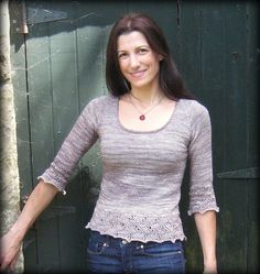 """Elphaba Pullover by Mary Annarella.  The pattern includes a general description of and How-To for creating Horizontal Bust Darts for knitters who wish to add these for a more custom fit.  Elphaba is a top-down, seamless pullover with raglan sleeves, a scoop neckline, and a modified version of the Japanese Feather Lace pattern at the hem  cuffs. It is intended to be worn with 0-2"""" of negative ease depending on your fit preferences."""