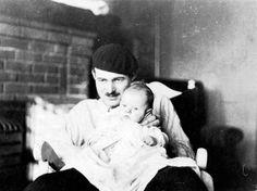 "Ernest Hemingway (wearing beret) holds his son, Jack ""Bumby"" Hemingway, in their apartment in Paris, France, circa 1924.  hemingwaybumby"