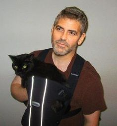 George Clooney with black cat