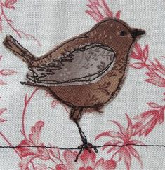 Love the way the bird is outlined with thread.  I'd love to add this to a quilt