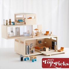 Although I love the idea of a modern doll house, I wonder if a little girl would actually like such simple architecture to play with, or if she would want the traditional Victorian fanciness.