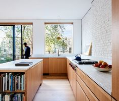 Modern Kitchen Design An Architect Breathes New Life Into a Brooklyn Row House - Shane Neufeld's year-old firm recently completed its first major project — the renovation of a dilapidated home in Bed-Stuy for his family. Kitchen Stove, New Kitchen, Kitchen Dining, Kitchen White, Kitchen Wood, Walnut Kitchen, Kitchen Hardwood Floors, Kitchen Island Oak, Kitchen Glass Doors