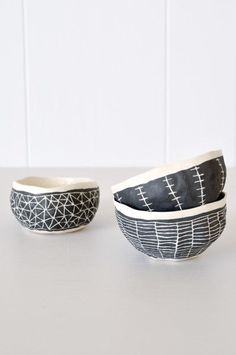 Hand-pinched bowl in black and white from Brooklyn artist Suzanne Sullivan. Pinch pots with slip scraffito