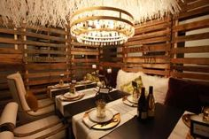 """Diffa Chicago's """"Dining by Design"""" - Strips of recycled paper formed a feather-like canopy over the setting designed by Aria Group for Cooperativa Ceramica D'Imola North America."""
