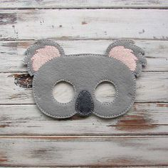 Is that your kid or a koala? When he or she is wearing the koala mask, you may need to try to serve the little gray-faced creature in front of you some eucalyptus leaves to know for sure! This adorable mask has all the features of the cuddly Australian bear with a tear-drop shaped nose and fluffy pink and light grey ears. Felt kids mask is handmade, and makes great party favors for the kids birthday party. Your child will have hours of fun imaginary play with this cute koala bear mask…