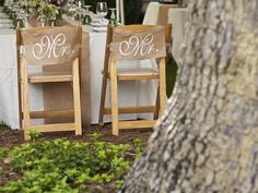 Mr. and Mrs. chair signs in cursive add elegance to otherwise strictly rustic wedding decor. #countrywedding http://www.gactv.com/gac/photos/article/0,3524,GAC_42725_6075192_01,00.html?soc=pinterest