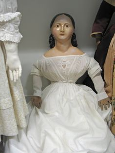 Here's a sampling of papier mache dolls.    The beauty above looks a bit haughty.     I don't know the maker of these - Voit?     I love t...
