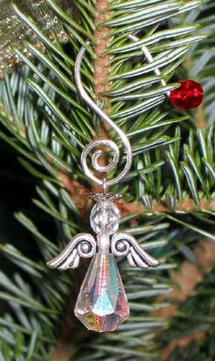 Materials List: 15mm AB finish drop clear crystal, silver angel wing bead, 6mm clear round crystal and 8mm silver bead cap   flipped upside down on a silver headpin.  Angel is hanging from a silver ornament hanger that I made.  Helpful Hint: You may also try stringing this completed project onto a decorative safety pin, bookmark, necklace, or earrings.