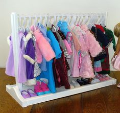 This beautiful, handcrafted Doll Clothes Rack is designed to hang your 18 doll clothes. Our doll clothes rack provides ample room for your doll clothes while providing lots of room for shoe storage and accessories below. Our large doll clothes rack accommodates 24+ doll outfits.  Our clothes rack not only provides storage for her doll clothes, but will provide hours of fashion dress-up play.  Our doll furniture is handcrafted of solid hardwood and is completely assembled. We do not use soft…