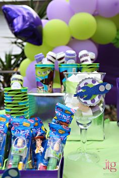 Toy Story Party.  I couldn't afford to do all of this so I did it on a much smaller scale.  I made a similar banner, I did the rocket ship deco on glass vases for favors, I did the Pez dispensers, and some things of my own.  Great party!