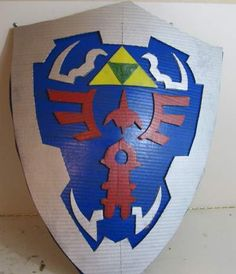 In this tutorial I show you how to make a nice zelda hylian shield. All you need is a couple of pieces of cardboard and some paint.