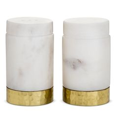 • Marble and Hammered Metal<br>• 2 and 3 Hole Openings<br><br>The Marble Salt and Pepper Shakers from Threshold take a place of prominence on your table. The shakers are made of marble with a hammered metal base in a gold tone and will impress your guests.