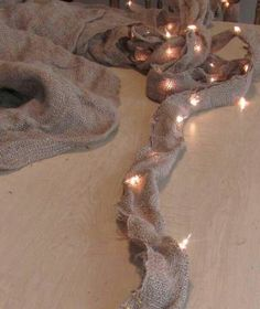 {Just the image ~ no details} Lights and burlap ~ this gives me an idea...