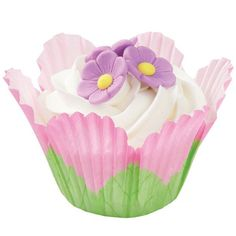 Petal Cupcakes - This flower blooms a sweet cupcake surprise nestled in Pink Petal Baking Cups and decorated with Purple Posies icing decorations. It's a fantastic and easy dessert to bake for Easter and any spring festivity.