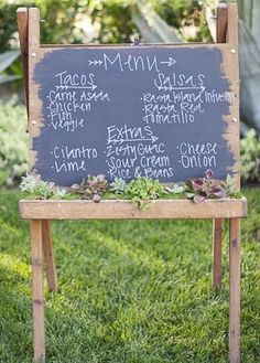 turn a chalkboard into an outdoor planter where you can write sweet notes...or menu's for summer dinner parties