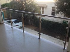 """At the Mount Vernon Project town homes we were brought in to do the balcony railing. For this project we used our cubed glass panel railing system – our 1 9/16"""" top mount square newel posts and railing with 316 (marine grade) stainless steel. The look was completed using 3/8"""" clear tempered glass with flat polished edges."""