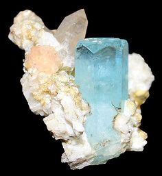Aquamarine with Fluorite, Quartz, Muscovite, and Albite! The Aquamarine color is beautiful and there are also Schorl crystals present in the matrix.  A light pink Fluorite crystal is located just out of view behind the terminated Aqua.  From Nagar, Hunza Valley, Northern Areas of Pakistan. Measures 8 cm by 9 cm by 7.5 cm in size.