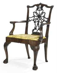 AN IRISH GEORGE III-STYLE MAHOGANY OPEN ARMCHAIR - 19TH CENTURY - The rockwork-carved waved toprail above a pierced ribbon, c-scroll and foliate-carved splat, with outcurved arms terminating in eagle's masks, on cabochon-headed cabriole legs and claw-and-ball feet 40½ in. (103 cm.) high Rococo Furniture, Georgian Furniture, Fine Furniture, Furniture Styles, Wood Furniture, Irish Decor, Dining Chairs, Wood Chairs, Love Chair