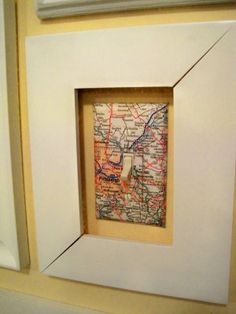 Upcycled map to cover light switch...making it a design element. I have only done the switch plates like this so far. Not sure if I will do the frame around it. I did all the switch plates in sons room.