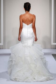 Dennis Basso Strapless Mermaid Gown in Satin This mermaid gown features a strapless neckline with in satin and tulle. It has a chapel train. This gown is Exclusive to Kleinfeld Bridal.  Style Number:33260993 Price:$$ ($3001 - $5000)