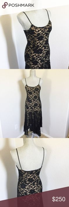 WHBM Unique Dress Black Lace SEXY Size Medium This is possibly the sexiest dress I've ever seen. I worked at an upscale WHBM in the early 2000s before they were big. Only a few of this dress came in & I snatched this one up despite the high price tag. They were sold out immediately & I've never seen one again. Only worn once. Swishes beautifully around your calves when you walk or dance. It's like flamenco dancer meets Marilyn Monroe. A very special, rare dress. A tight medium. Flattering…